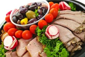 Smartly dressed guests can relax around a cold cuts platter.