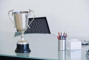 Make a cup trophy using craft materials.