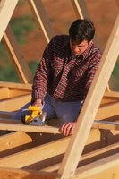Making wood gussets is one step in building a roof system.