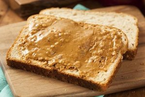 A piece of toast with peanut butter.