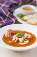 Shrimp  tails add texture and crunch to the stew, but you can remove them.