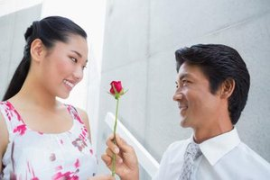 Korean man giving a flower to his date.