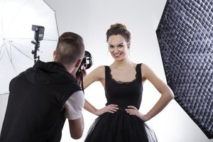 Smiling young model being photographed.