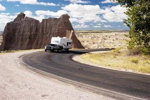Fifth wheel camper driving on a mountain road