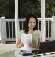 A tax preparer reviewing income tax forms