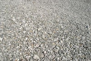 how to stop gravel moving on driveway