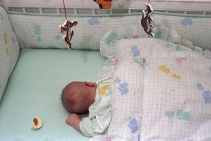 Precautions should be taken to keep your cat from jumping into the crib with your newborn baby.