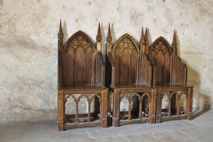 Gothic Revival chairs with church architecture.