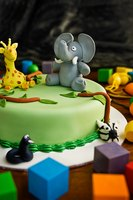 A three-dimensional, seated elephant requires some advanced cake decorating skills.