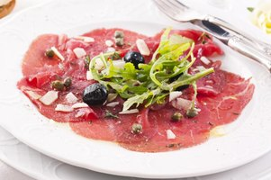 Carpaccio refers to any thinly sliced raw meat served with a sauce.