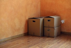 Three boxes in the corner of an empty room.