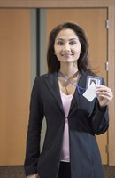 Business woman holding up PERC card.
