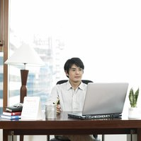 Man working productively at desk in office.