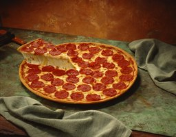 One piece of pizza out of eight, expressed as 1/8, is equal to 0.125.