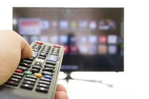 A remote is pointing at a smart TV.