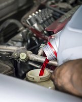 Close-up of transmission fluid being poured into car engine