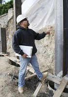 Construction worker inspecting work site