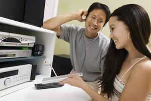 A young couple setting up their home entertainment system