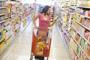 Woman reading label in grocery store.