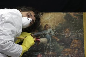 Art restorers work on frescoes, sculptures and even building facades, in addition to paintings.