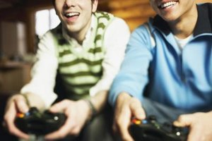 Close-up of teenage boys playing video games.