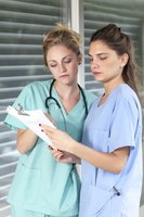 Nursing assistant going over paperwork with nurse