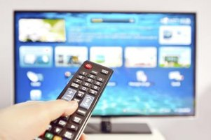 Pointing a remote at a smart TV.