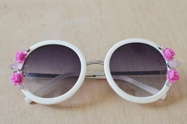 Upgrade a pair of sunglasses with flower embellishments.
