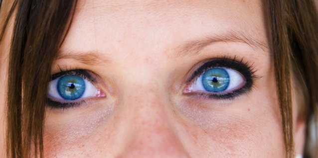 Colored contact lenses can enhance eye color.
