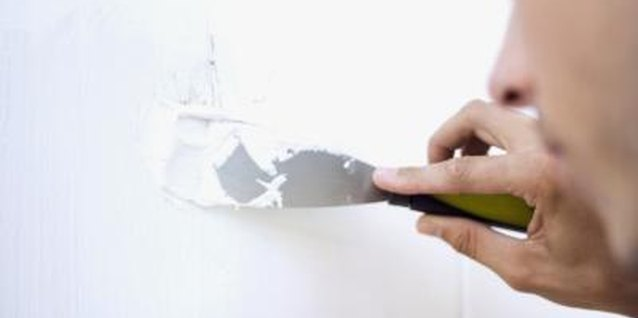 Quick-drying spackle can quickly fill small holes.
