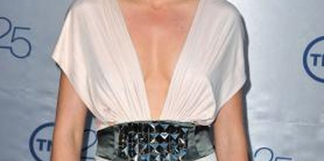 Use fashion tape to secure a dress featuring a deep, V-shape neckline.