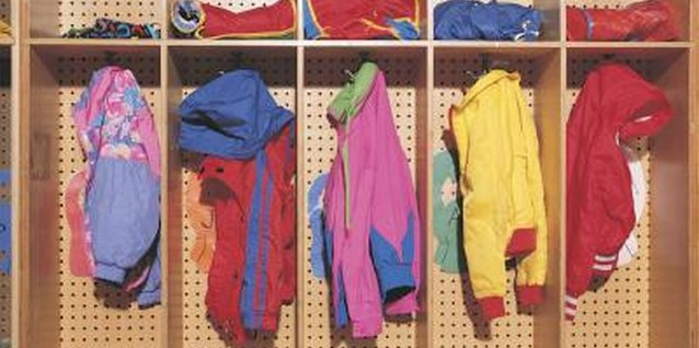 Create a wall cubicle for each child to hang jackets and backpacks.
