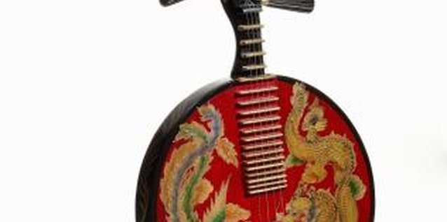 Ethnic musical instruments can be wall sculptures in your home.