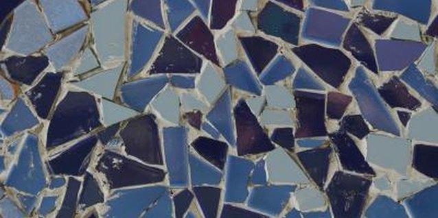 Use broken tile pieces to create a mosaic stepping stone or table.