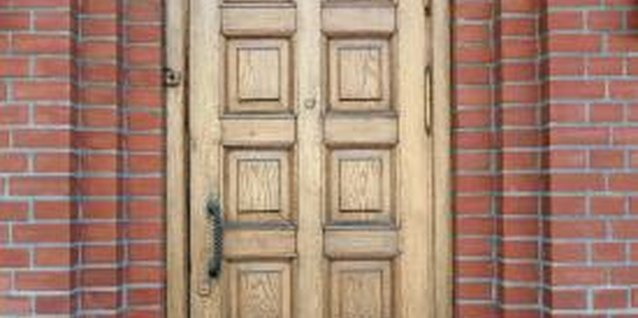Staining and glazing are two ways to add life and character to a wooden door.