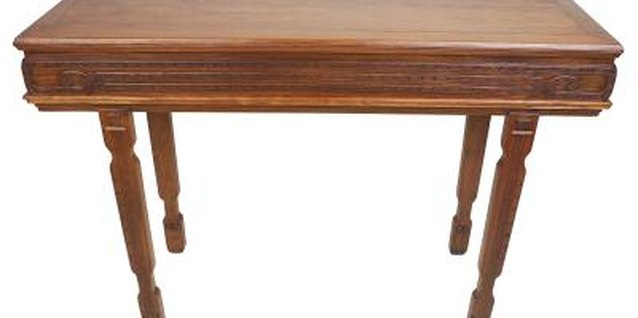 The turned wood details on these table legs provide a ready made guide to use in bringing down the height.