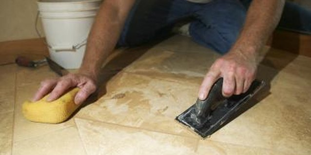 Tile grout may take on a darker color when wet but will slowly lighten.