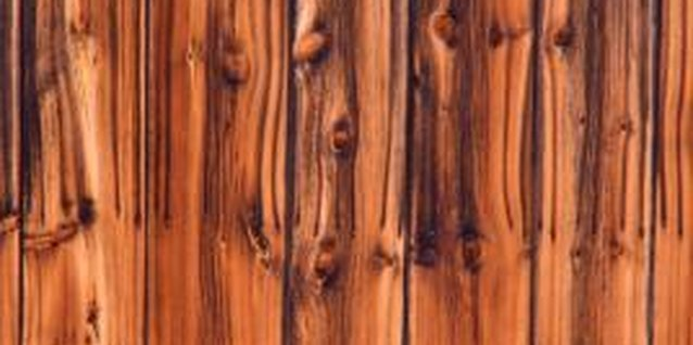 Paneling contains a stain or glossy finish that repels or shows through paint.