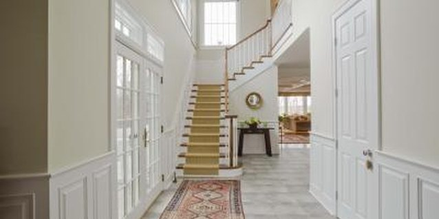 White walls, light-colored floors and natural light brighten a foyer.