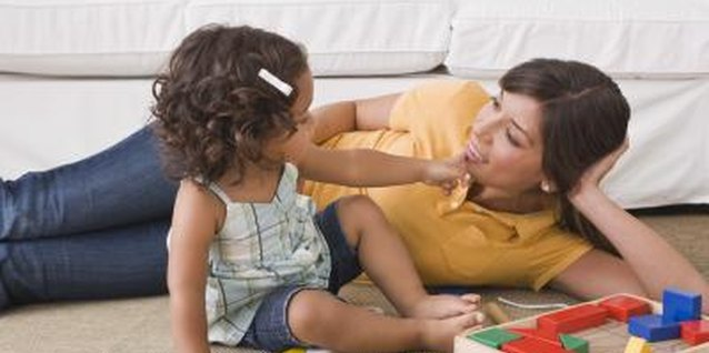 A girlfriend playing with a toddler can encourage bonding.