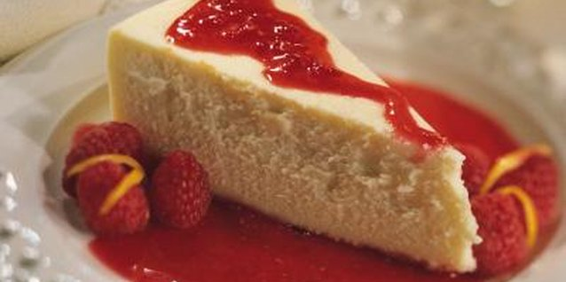 Top cheesecake with whole, frozen berries or a berry sauce.