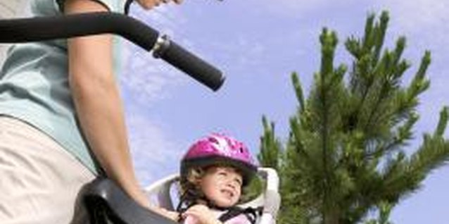 Toddlers should be secured in their bicycle seats.