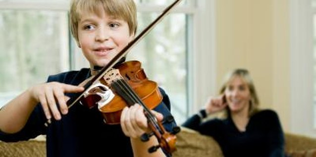 Violin lessons include both instructor and parent involvement.