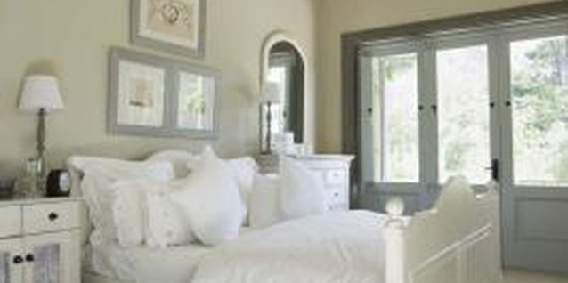 White bedding gives a fresh, crisp appearance to a white bed.