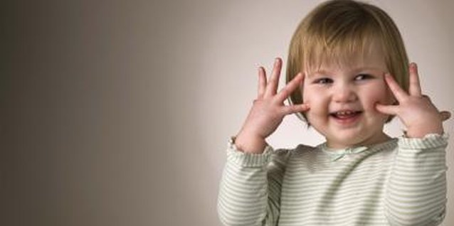 "Your toddler loves hand motions like ""peek-a-boo."""