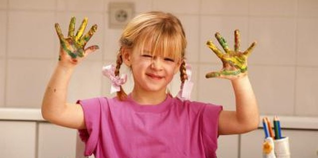 Tactile defensive children may be fearful of messy activities like finger painting.