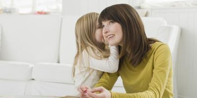 Whispering games help teach your little one to use her indoor voice.