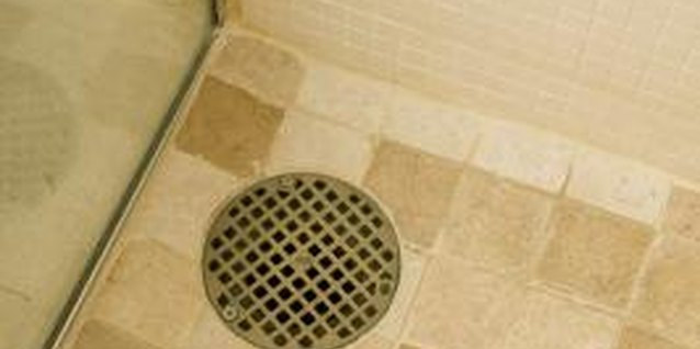 Plumber's putty will seal shower drains set in tiled floors or tub bottoms.