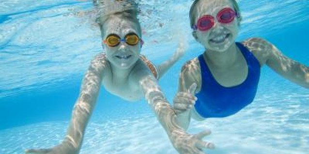 Teach your child underwater warm-ups to prepare for the exercise of swimming.