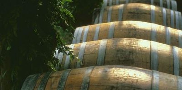Slow-growing shrubs work best for wine half-barrel planters.
